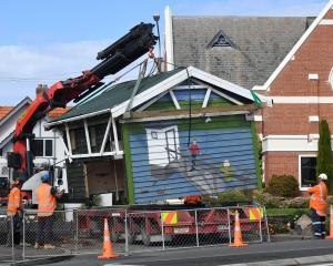 A crane lifts the bus shelter in Drivers Rd, Maori Hill, from its foundations yesterday. PHOTO:...