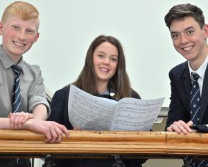 New Zealand Secondary Schools Choir members Teddy Finney Waters (14), Elizabeth Purvis (16) and...