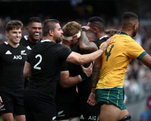 Dane Coles of the All Blacks  pats Lukhan Salakaia-Loto of the Wallabies on the back during the...