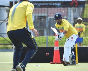 Otago batsman Anaru Kitchen plays a defensive shot to a delivery from Michael Rippon on the...