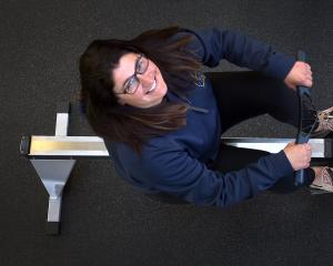 Emma Barker has a go on rowing machine as she takes a break from her new role as the Otago Rowing...