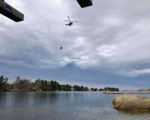 Helicopters were helping to fight the fire on Sunday afternoon. Photo: Simon White