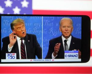 A smartphone screen shows US President Donald Trump (L) and Democratic presidential candidate Joe...