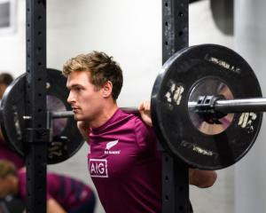 George Bridge lifts weights during a recent All Blacks gym session in Wellington. Photo: Getty