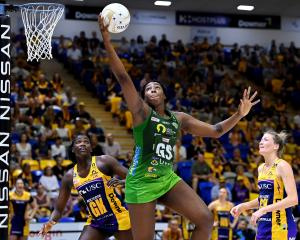 West Coast Fever goal shooter Jhaniele Fowler hauls the ball in as Sunshine Coast Lightning...