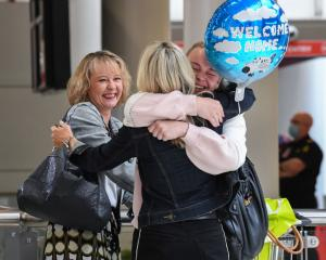 Friends greet each other at Sydney's Kingsford Smith Airport after the first flight from New...