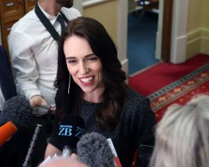 Prime Minister Jacinda Ardern talks to reporters at Parliament in Wellington. Photo: Getty