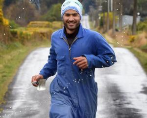 Woodside dairy farmer Harrie Chander is training to run the Queenstown Marathon in his work...