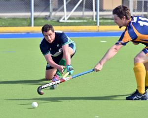 Kings United player Hitaua Arahunga-Doyle (left) looks to move the ball past Taieri Tuataras...
