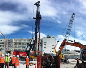 March Construction workers prepare for a test pile to be drilled at the new Dunedin Hospital site...