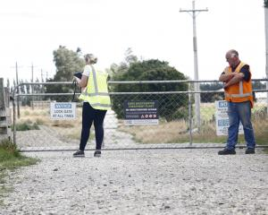 A WorkSafe New Zealand official examines the Gore sewage plant gate through which the 3-year-old...