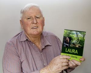 John Ferris with his book. Photo: Geoff Sloan