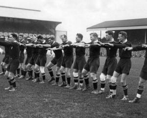The 1924 Invincibles perform the haka at Twickenham Stadium in London. Photo: Webbs (with...