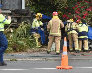 Emergency services attend an accident in Kaikorai Valley Rd near KFC on Thursday afternoon. PHOTO...