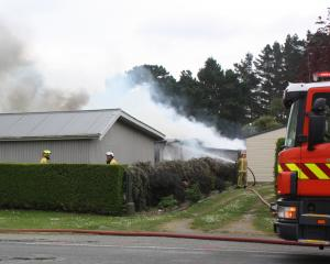 Smoke rises from the shed fire at a property in Kakanui. Photo: Gus Patterson