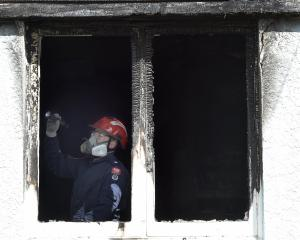 Fire and Emergency New Zealand investigator Scott Lanauze examines an Oban St, Mosgiel house...