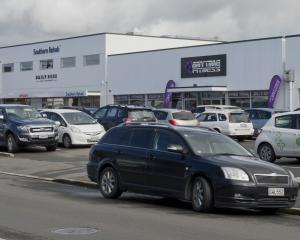 Four car parks in Macandrew Rd will become five-minute parks after support from nearby businesses...