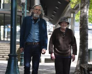 Poet, writer and publisher Roger Hickin (left) and Dunedin poet and photographer Peter Olds walk...