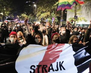 People protest against imposing further restrictions on abortion law in Poland in front of the...