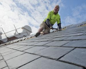 John Meegan Roofing owner John Meegan adds another slate tile to the thousands he is putting on...