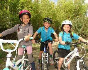 About to tackle a new bike trail on the Shotover River delta are (from left) Esther Nai (6),...