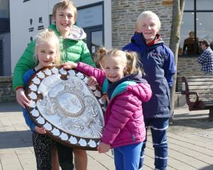 Posing with the Ranfurly Shield in Queenstown yesterday are (from left) Liliana McGregor (8), Max...