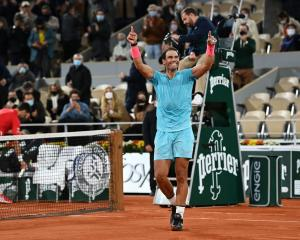 Rafael Nadal celebrates after claiming his 13th French Open title. Photo: Getty Images