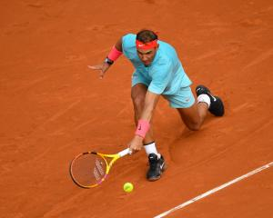 Rafael Nadal plays a backhand during his second round win at Roland Garros this morning. Photo:...