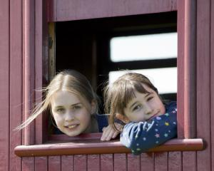 Enjoying the Ocean Beach Railway experience are sisters Jade Anderson (11, left) and Opal...