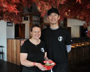 Gillian and Yuya Sugiyama with a bowl of ramen in their Takeichi Ramen restaurant that opened...