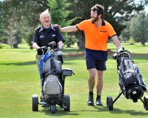 Bill Graham (left) and Sam Miller play a practice round in Ranfurly yesterday in preparation for...