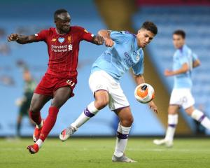 Sadio Mane of Liverpool battles for possession with Rodrigo of Manchester City during the English...