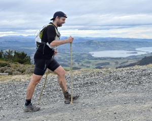 Scott Payne competes in the Three Peaks Mountain Race yesterday. PHOTO: LINDA ROBERTSON