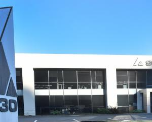 Scott Technology will keep its head office in Dunedin despite concerns the company's executives...