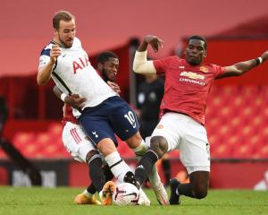 Harry Kane, Fred and Paul Pogba contest the ball during Tottenham's game against Manchester...