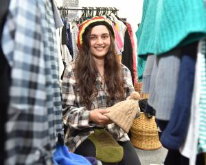 Bianca Keane, of Dunedin, picks up some essentials for free at the St Vincent de Paul shop in...