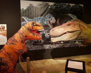 Rexie the T-Rex (Alfie Richardson, left) meets his ancestor at the Dinosaur rEvolution exhibition...