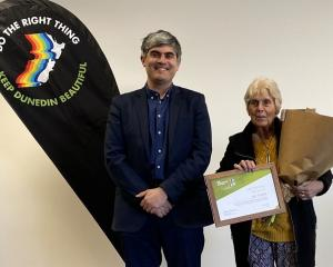 Keep Dunedin Beautiful chairwoman Jan Tucker is congratulated on being awarded a life membership...