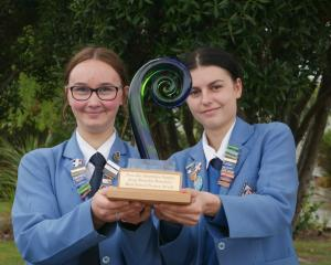 Queen's High School pupils Caitlyn Petrie and Tessa Conijn (both 16) hold the school's enviro...