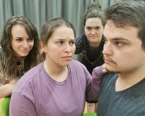Rehearsing for Jean Paul Sartre's vision of Hell, No Exit, for Arcade Theatre Company are (from...