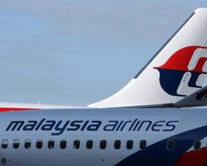 The Malaysian Airline System Bhd. (MAS) logo is displayed on the company's aircraft at Kuala...