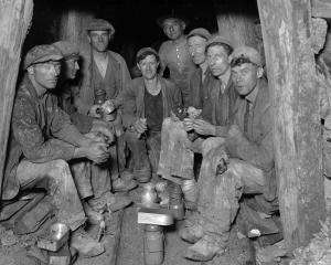 Waiuta miners pause for crib. Photographer and miner Joseph Divis is fifth from the left. PHOTO:...