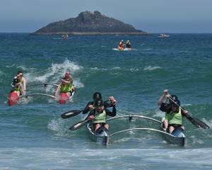 A Kaka Point crew leads a Warrington crew to the beach in the 51st White Island race. PHOTOS:...