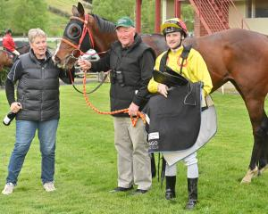 Owner-trainers Nikki and Barrie Blatch and jockey Jacob Lowry celebrate with race 2 winner Mr...