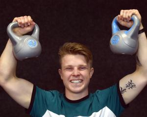 Brahm Richards holds a pair of kettlebells at the National Wrestling Championships at Taieri...