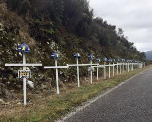 White crosses line the road to the Pike River Mine in tribute to the 29 miners who died when the...