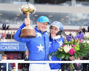 Self Assured trainer-driver Mark Purdon and co-trainer Natalie Rasmussen celebrate winning the...
