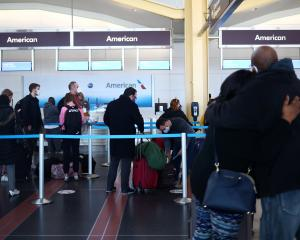People queue at Reagan National Airport in Washington ahead of the Thanksgiving holiday. Photo:...