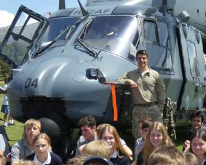 Flight Lieutenant Tom McDowell treats Cromwell College pupils to a visit by the Royal New Zealand...
