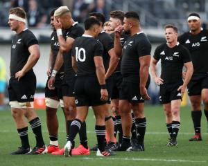 The All Blacks look dejected after defeat during the 2020 Tri-Nations rugby match with the...